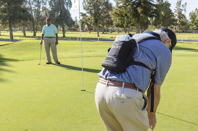 Man golfing with the Caire FreeStyle Comfort.