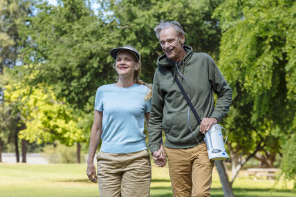 Man and woman with oxygen concentrator