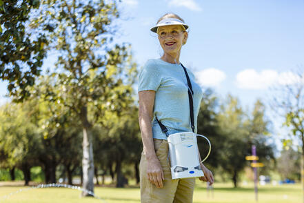 Woman in park with the Caire FreeStyle Comfort