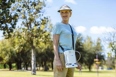 Woman walking with the Caire FreeStyle Comfort.