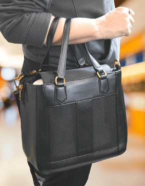 Woman carrying GO2 carryall