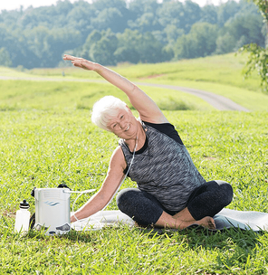 Woman doing yoga with the Caire FreeStyle Comfort