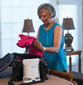 Woman packing bags with the Caire FreeStyle Comfort.