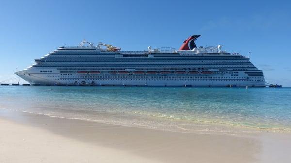 Cruise ship near a beach.