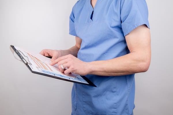 Doctor examining a clipboard