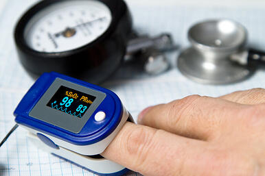 Pulse oximeter device on a finger.