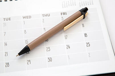 Schedule with a pen on it.