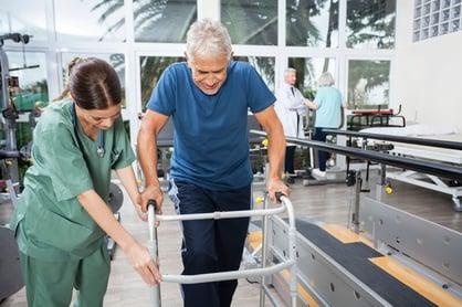 Woman helping man with pulmonary rehabilitation.