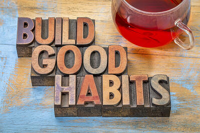 "Sign that reads ""build good habits."""