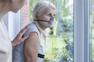 Woman wearing oxygen mask.