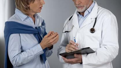 Woman discussing test results with her doctor.