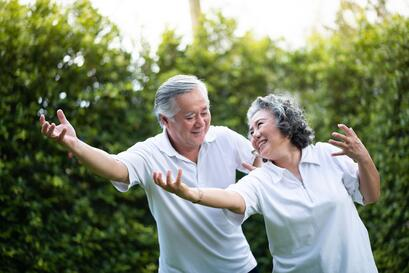 Man and woman practicing Tai Chi together.