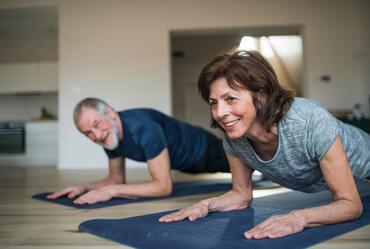 Man and woman exercising indoors.