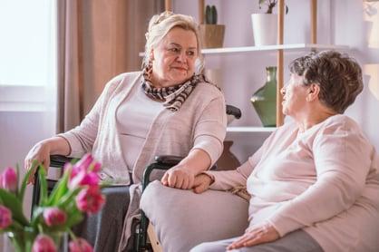 Elderly woman speaking with her friend