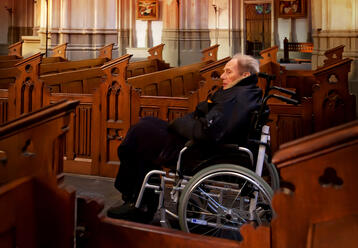 Woman in wheelchair at church.