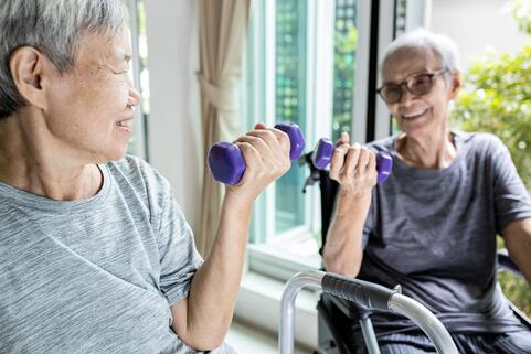 Old women lifting weights