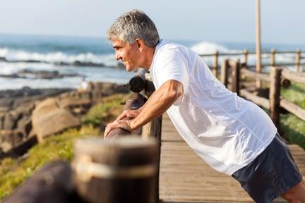 Man exercising on the beach.