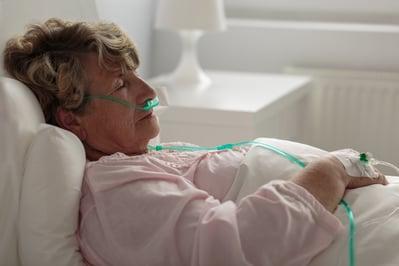 Woman with nasal cannula.