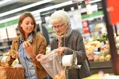 Two women at a grocery store.