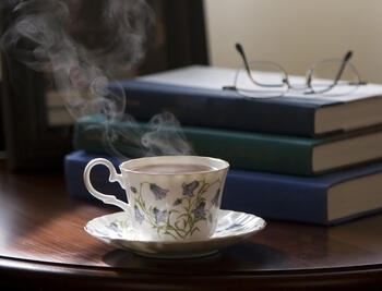Table with books and tea on it