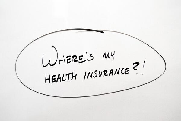 "Whiteboard that says ""where's my health insurance?"""