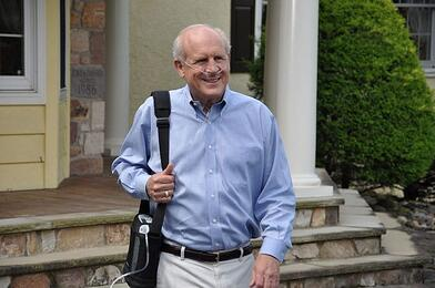 Man walking with a portable oxygen concentrator.