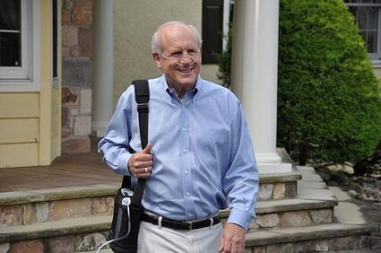 Man walking with portable oxygen concentrator.