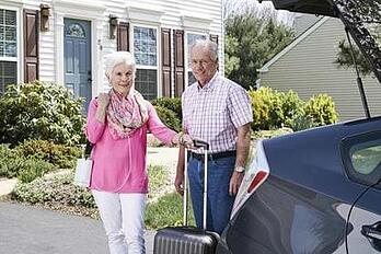 Lady and man with oxygen concentrator.