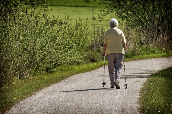 Woman hiking down a path.