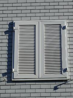 Window with shutters closed.