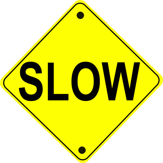 "Yellow sign that says ""slow."""