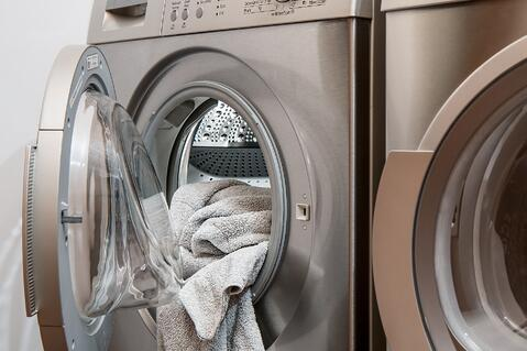 Washing machine with towels in it.