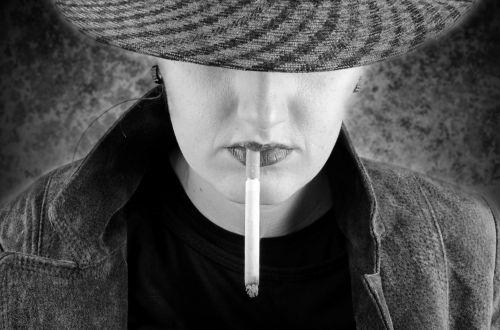 woman-smokes-a-cigarette-1387640353R5m