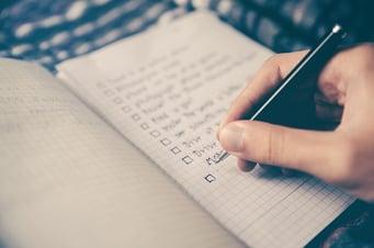 Writing goals in a notebook