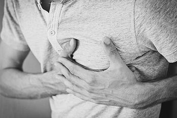 man experiencing chest pain.