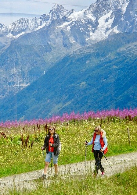 Two women hiking through the Alps.