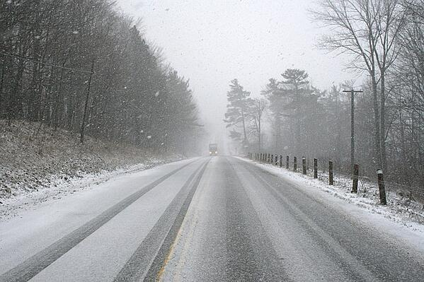 Winter road with snow on it.